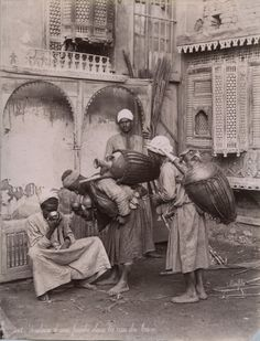 Water carriers in Cairo. Ca. 1880