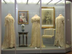 "A couple of Empress Alexandra's ""loose, flowing dresses"" on display at Pavlovsk"