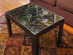Coffee table is made up of recycled steel, glass and wine bottle ...