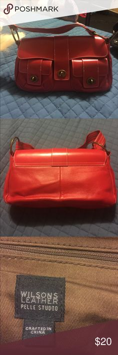 Wilson Leather Red Purse excellent used condition Wilson Leather Red Purse excellent used condition. Used once or twice. Slight discoloration on rings for shoulder straps. Wilsons Leather Bags Shoulder Bags