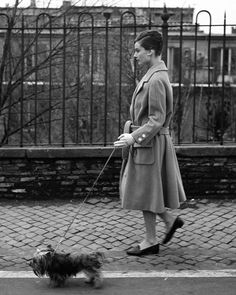Audrey Hepburn walking her dog Mr. Famous in Rome, 1959. #audreyhepburn