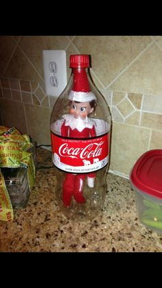 Elf on the Shelf, how did he get in that Coca Cola bottle??