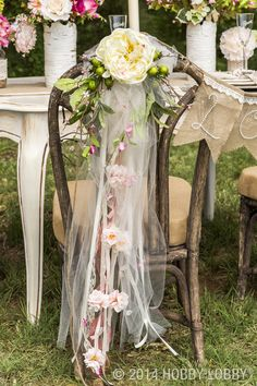 Turn any seat at the reception into a lovely place to land with a trailing this-and-that bouquet, wired to the chair back. For more great wedding ideas, click here!