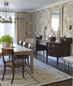 love fabric upholstered walls (Peter Dunham Samarkand pattern on walls) with nailhead trim (alternating sizes)