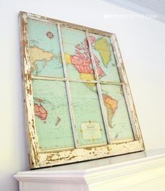 DIY vintage Window map - If you have an old map and some type of older window or mirror, you can instantly create this cool map wall hanging decoration for your travel theme classroom!