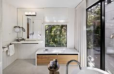 Full mirror with light and faucet embedded.   http://www.dwell.com/house-tours/slideshow/bright-renovation-1970s-home