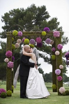My favorite wedding arch idea. Only use DIY pom poms out of fabric or tissue paper for the flower balls.