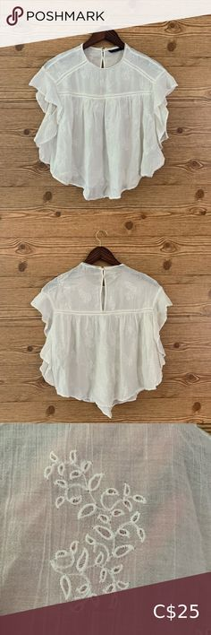 ZARA WHITE 100% COTTON BLOUSE EMBROIDERED RUFFLE Super sweet 100% cotton top from Zara   Super feminine and features embroidery work on the material, ruffles, crochet lace trim, enamelled buttons at the nape of the neck.   Very romantic, light and airy.   In very good preloved condition and the only flaw to note is a small amount of wear on the trim at the back of the neck. Zara Tops