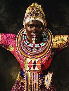 the colors are vibrant, her facial expression says it all. african queen.