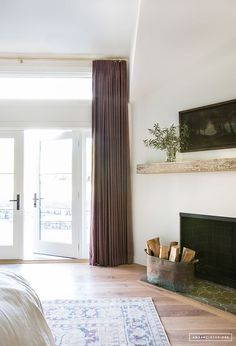 FIREPLACE - hearth and simple driftwood mantle