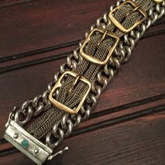 "Lucky Brand chains and buckles bracelet Lucky you!  Lucky Brand two toned metal bracelet, excellent used condition, strong magnetic closure with side claps for added security, you will love this! 1"" wide 7 1/4"" long, priced has been reduced and is firm Lucky Brand Jewelry Bracelets"