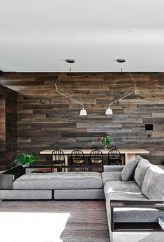 An amazing feature wall constructed with timber boards. The varying tones gives an organic touch to this crisp space. The grey finish flows well with the modern furnishings.