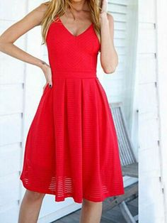 ab2c7e852b This red V neck sundress features a pleated knee-length skirt and ...