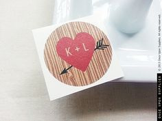 1.5 Round Red Heart & Arrow Tree Bark Round by OnceUponSupplies, $40.00