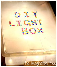 Create a light box vs. expensive light table - The Imagination Tree: DIY Light Box for Sensory Play. Example of natural or reusable materials: negatives of pictures from local 2nd hand store, small plastic animals, shells,  different styles of feathers, change the color of lights inside, letters, etc... have fun!