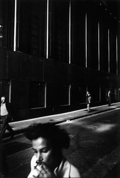 Office workers light up cigarettes on their way to Town Hall train station after finishing work for the day.  Sydney, Australia 1999  From Dream/Life series  Trent Parke
