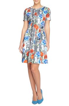 Free shipping and returns on Catherine Catherine Malandrino 'Vondie' Print Scuba Fit & Flare Dress at Nordstrom.com. Vibrant color washes over the abstract print that energizes a darling day dress cut from a smooth scuba-inspired knit. A crewneck and short sleeves detail the classic fit-and-flare design.