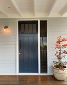 Paint exterior Tranquil Retreat and front door Dulux Grid - the warmest of navy blues. Dulux Exterior Paint Colours, Exterior Gray Paint, House Exterior Color Schemes, White Exterior Houses, Exterior Paint Colors For House, Exterior Doors, Outdoor House Paint, Light Blue Houses, Outside House Colors