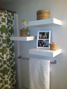 wall shelves over towel rack