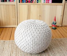 Knitted cover for yoga ball. I want to do something like this so mine isn't an ugly green blob sitting in my living room.