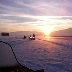 snowmobiling in sunset