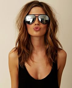 Not sure if its the Mirrored Aviator Sunglasses or the chick but this pic is hawt!