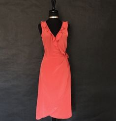 """This is a lovely Zelie Brand wrap around Flare dress. The dress is sleeveless, has a v-neck line and falls below the knees.    It is a size Mediumwith the following measurements:    Length 44""""    Bust 39""""    Waist 29""""    This item ships immediately. 📦 It is also available for local try on and pick up in Sacramento, CA. 