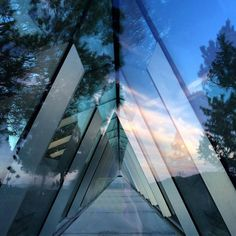 "Designed by the architect Moshe Safdie, the Yad Vashem Holocaust History Museum is a prism-like triangular structure that penetrates the mountain from one side to the other. Moshe Safdie: ""I wanted just the basic structure – concrete walls and floors, and glass to let the light in from above""."