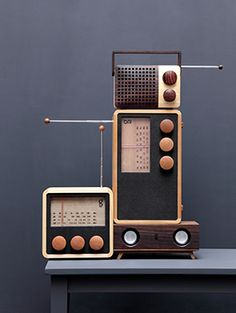 Working wooden radio hand made.  Company replants trees for each one used in radio production.