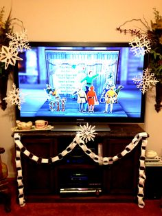 "For the Elf movie night, they decorated the tv ""Elf"" style!"
