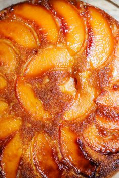A lush combination of a Southern upside-down cake and a French tarte tatin, this cake is deeply caramelized on top and light and fluffy beneath. Peach Upside-Down Skillet Cake With Bourbon Whipped Cream - NYT Cooking Bourbon Whipped Cream Recipe, Peach Upside Down Cake, Skillet Cake, Raspberry Ice Cream, Recipes With Whipping Cream, Bean Seeds, Well Seasoned, So Little Time, Sweets