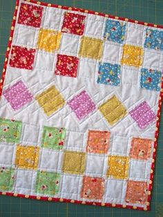 Variation on Ticker Tape quilt--scraps sewn in traditional block layouts-what a swell idea for all my leftover fabric!
