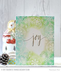 6 Oct 2015 : Rejoicing Crafts : MFT Snowflake Flurry stamp set. To create the card, I 1) Stamped the sentiment from the Hand Lettered Holiday stamp set at the centre of watercolour paper panel using embossing ink, gold heat embossed. 2) Stamped the snowflakes on the edge of that using embossing ink, white heat embossed.