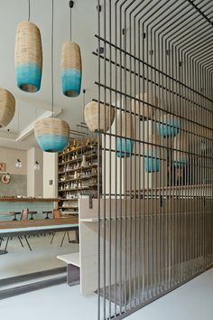 Screen and lighting fixtures. Love the light wood and turquoise. - gran fierro restaurant