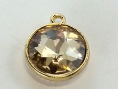 Beads One - Glass Pendant round 04 Lt Topaz, $0.70   #beading #supplies wholesale jewelry making #link #glass #beads (http://www.beadsone.com/links-and-connectors/beads-glass-pendant-round-04-lt-topaz.html)