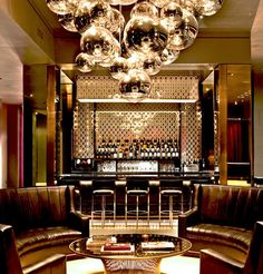 chandelier. reflective wall treatments.  Hotel Lola, NYC
