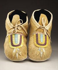A PAIR OF HIDATSA QUILLED HIDE MOCCASINS c. 1920