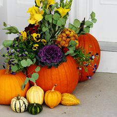 Make your front door inviting with this Autumnal decor. Fall plants, planted in a pumpkin are sure to please.