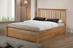 Monaco Solid Oak Ottoman Gas Lift Storage Bed in Double, King and Superking Size This oak ottoman bed is fantastic value and constructed to very high standards. It features a thick headboard and footboard and very thick side rails. It has a high quality frame with deep internal storage. The gas hydraulics are designed to take substantial weight and move up and down smoothly.