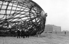 28-Members of the U.S. Navy Board of Inquiry inspect the wreckage of the German zeppelin Hindenburg on the field in New Jersey on May 8 1937. (AP Photo)