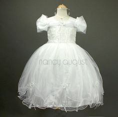 Delightful Princess White Flower Girl Dress: This princess white flower girl dress is a wonderful addition for any little girls princess party dress collection. Like a miniature wedding dress, this will be a perfect selection for your little angel who is on schedule to be a flower girl. This white flower girl dress is the perfect choice to make it a unforgettable day. The lovely organza dress features a ruched shoulder and is enhanced with mini rosettes with pearl centers throughout the…