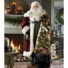 Life-size Father Christmas | Magnificent in garments of traditional red, green and white, this 5' tall Santa figure is rich in detail and character. His face is artistically created in resin, then hand-painted with magical detail. www.countrydoor.com