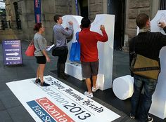 Combine an interactive prop and ground graphic at the entrance of an event and…
