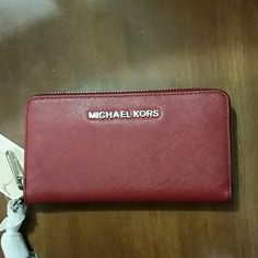 New Michael kors multi wristlet in chili red 6x4 inches ...3 credit card slots...silver hardware....chili red in color MICHAEL Michael Kors Bags Clutches & Wristlets