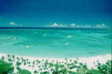 Aruba:  beautiful beaches, constant trade winds, turquoise Caribbean waters.  Love this place.