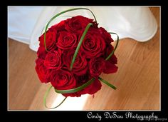 Stunning red roses with just a touch of green in this elegant bridal bouquet.