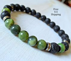 Jade bracelet, lava bracelet, Mens bracelet, reiki bracelet, healing bracelet, green jade, 8mm high quality Nephrite Jade 8mm lava rock. Hematite spacer beads Strung on strong elastic cord. Single Yoga Bracelets here: http://www.etsy.com/shop/LifeForceEnergy?section_id=10901055 More Yoga wrap Bracelets/Necklaces here http://www.etsy.com/shop/LifeForceEnergy?section_id=11305375 108 Malas Bracelet or Necklaces here http://www.etsy.com/shop/LifeForceEnergy?section_id=11310698 Jade is a symb...