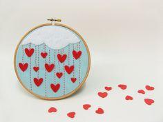 Embroidery hoop wall art  Rain of hearts, via Etsy.
