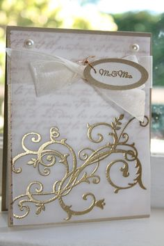 Gorgeous wedding card using vellum and embossing powder.  Very pretty gold on vellum.
