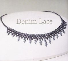 """gray beaded necklace  1/3  Materials needed:  - Crystals color """"wet asphalt""""  - beads of the same color  - nylon thread  - Clasp"""
